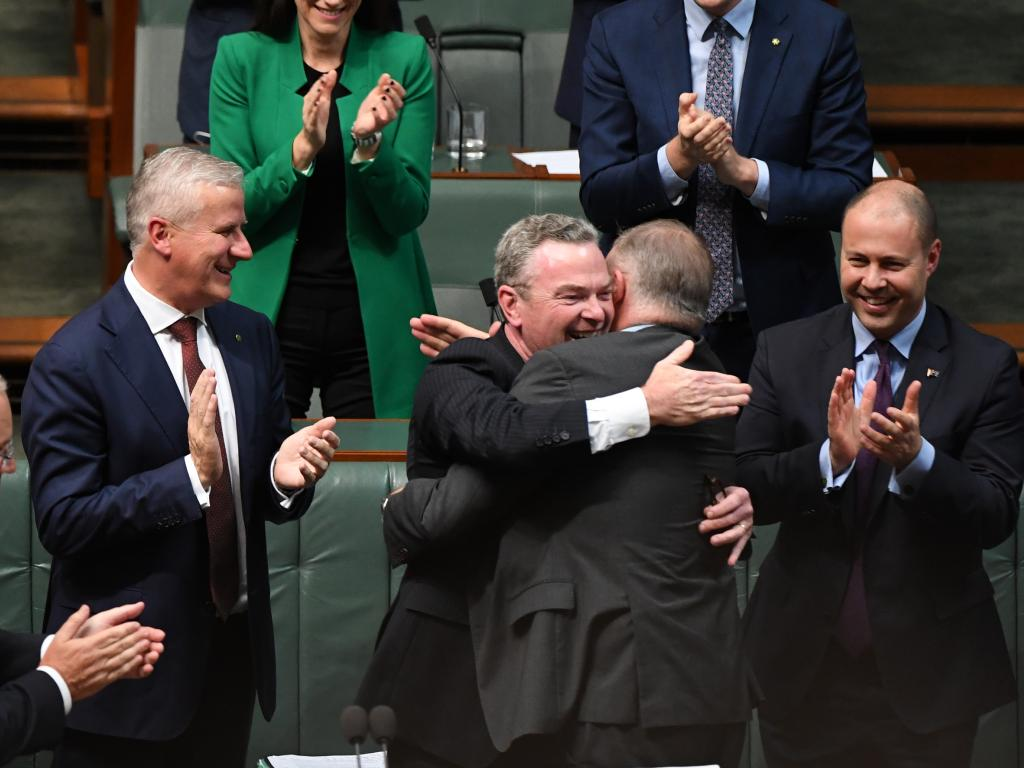 Shadow Minister for Infrastructure Anthony Albanese huged Mr Pyne after he delivered his valedictory speect. Picture: AAP/Sam Mooy