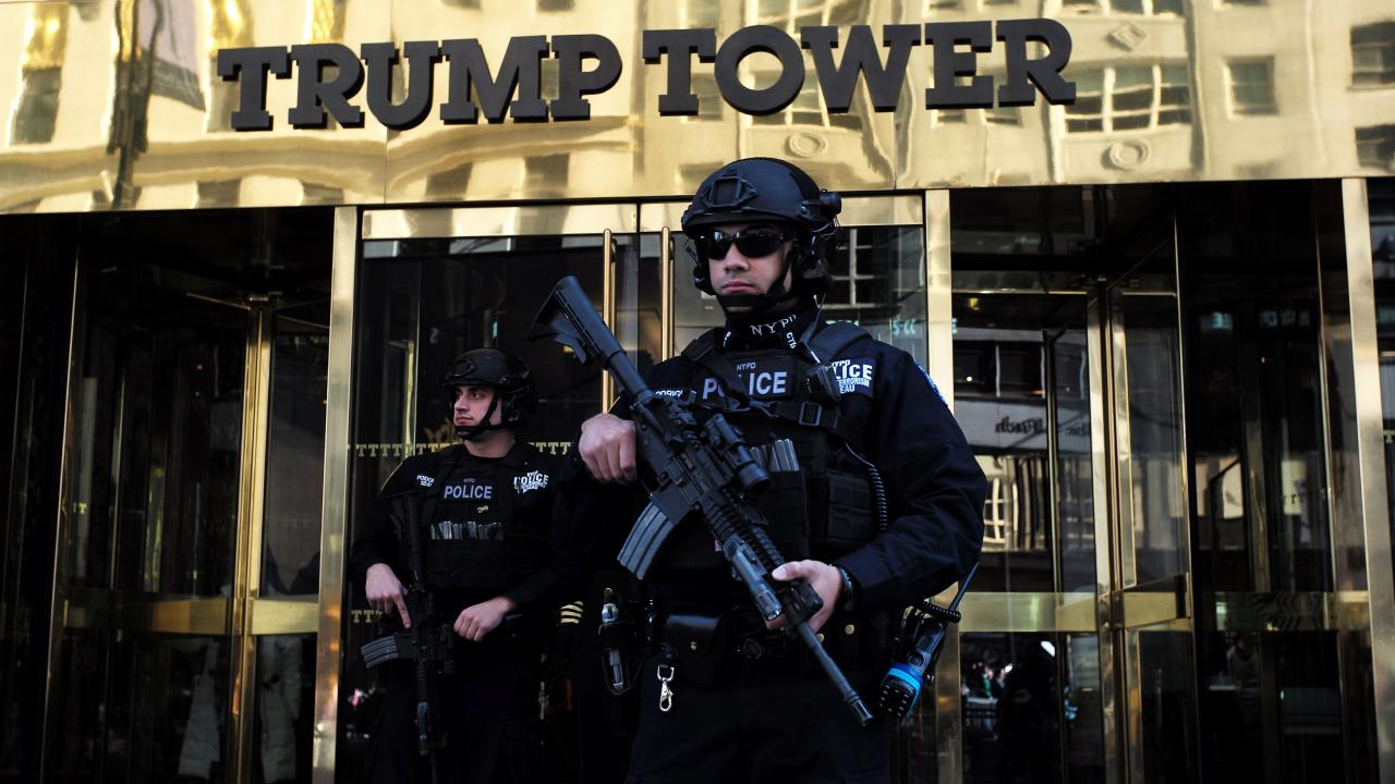 New York Police Department (NYPD) officers guard the main entrance of the Trump Tower. Picture: AFP / Jewel Samad.
