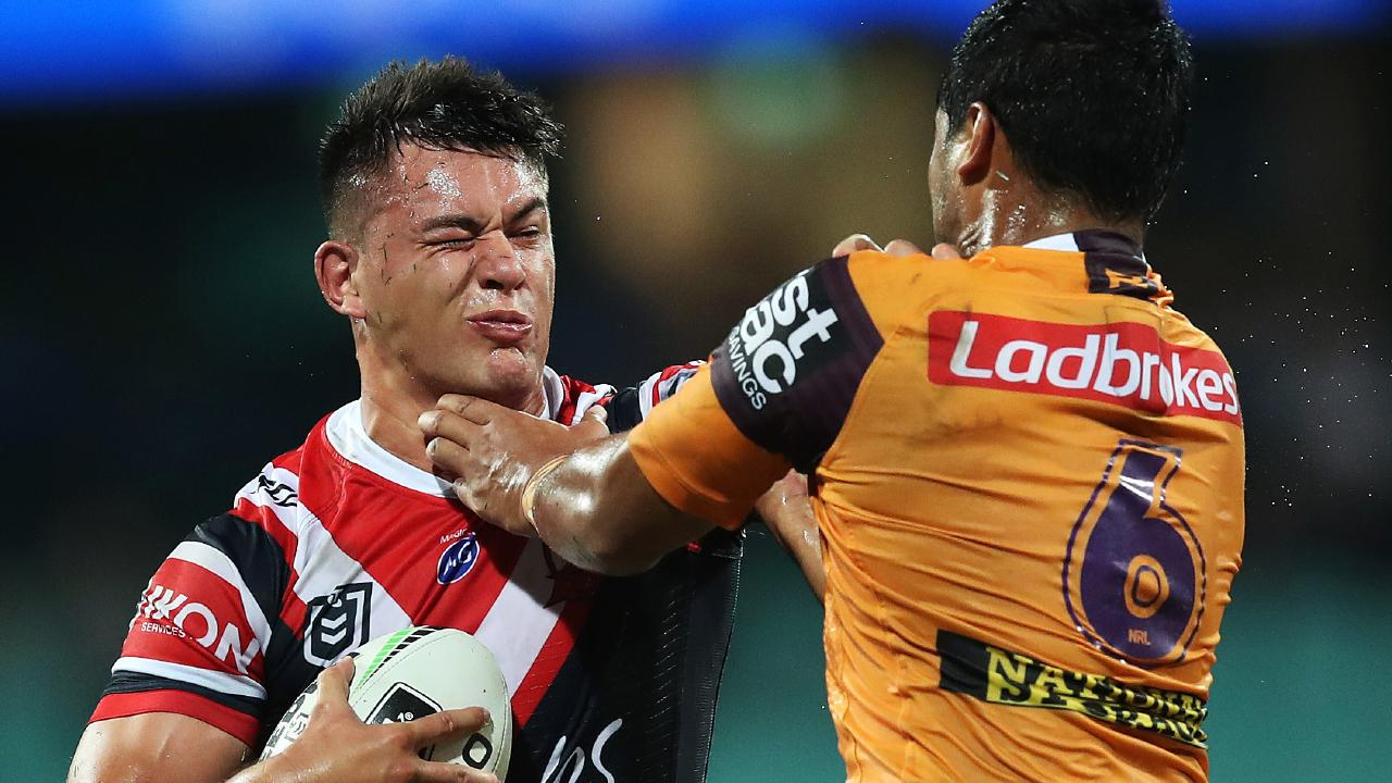 Roosters Joseph Manu looks to palm off Anthony Milford. Picture. Phil Hillyard