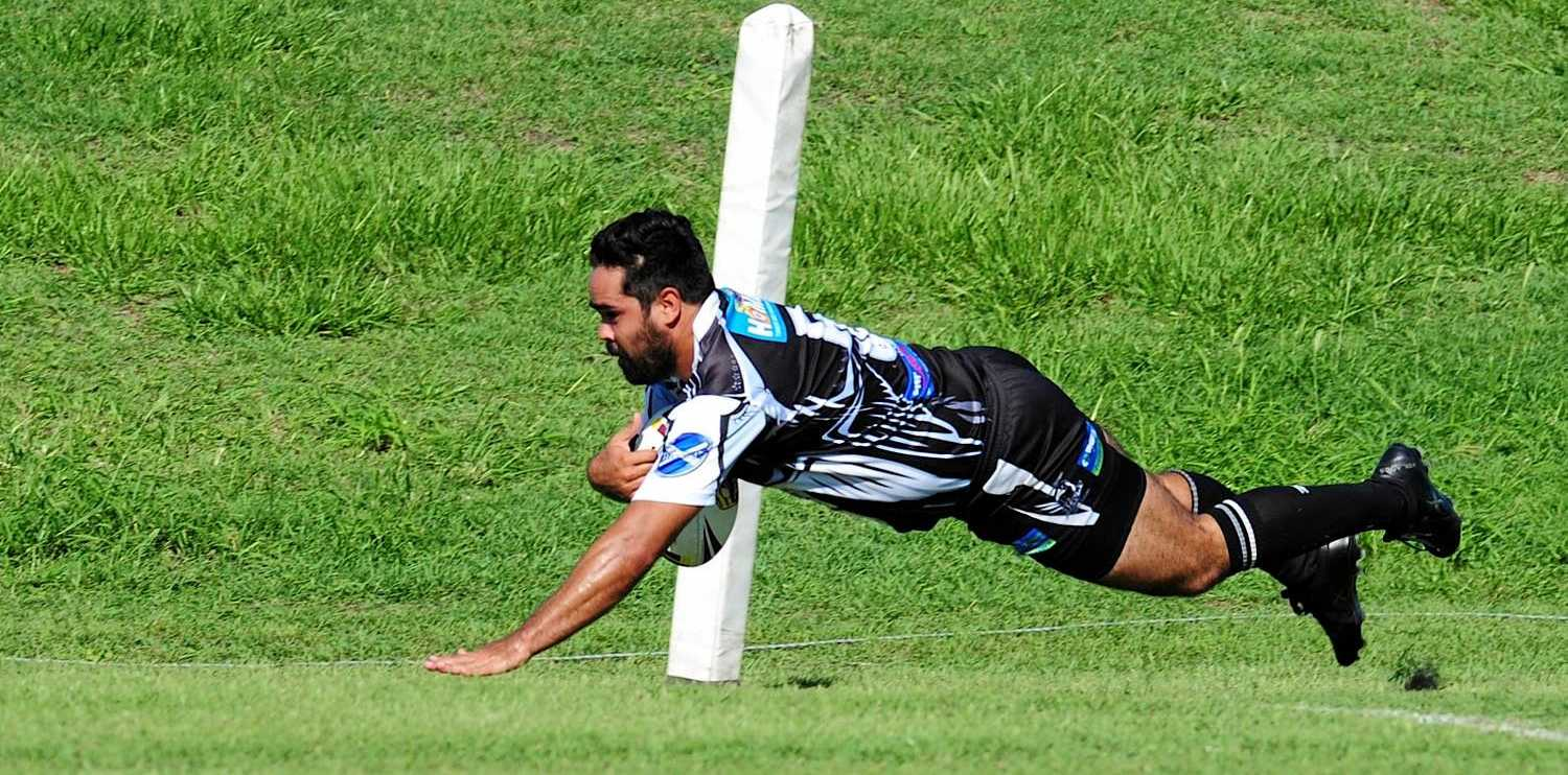 TRY TIME: Lower Clarence Magpies winger Dale Eamens crosses the line.
