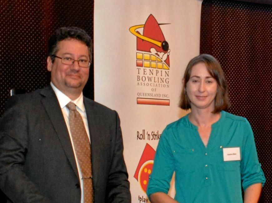 Tenpin Bowling Association of Queensland chair Michael McKenna presents Jessica Allen with the Volunteer of the Year award.