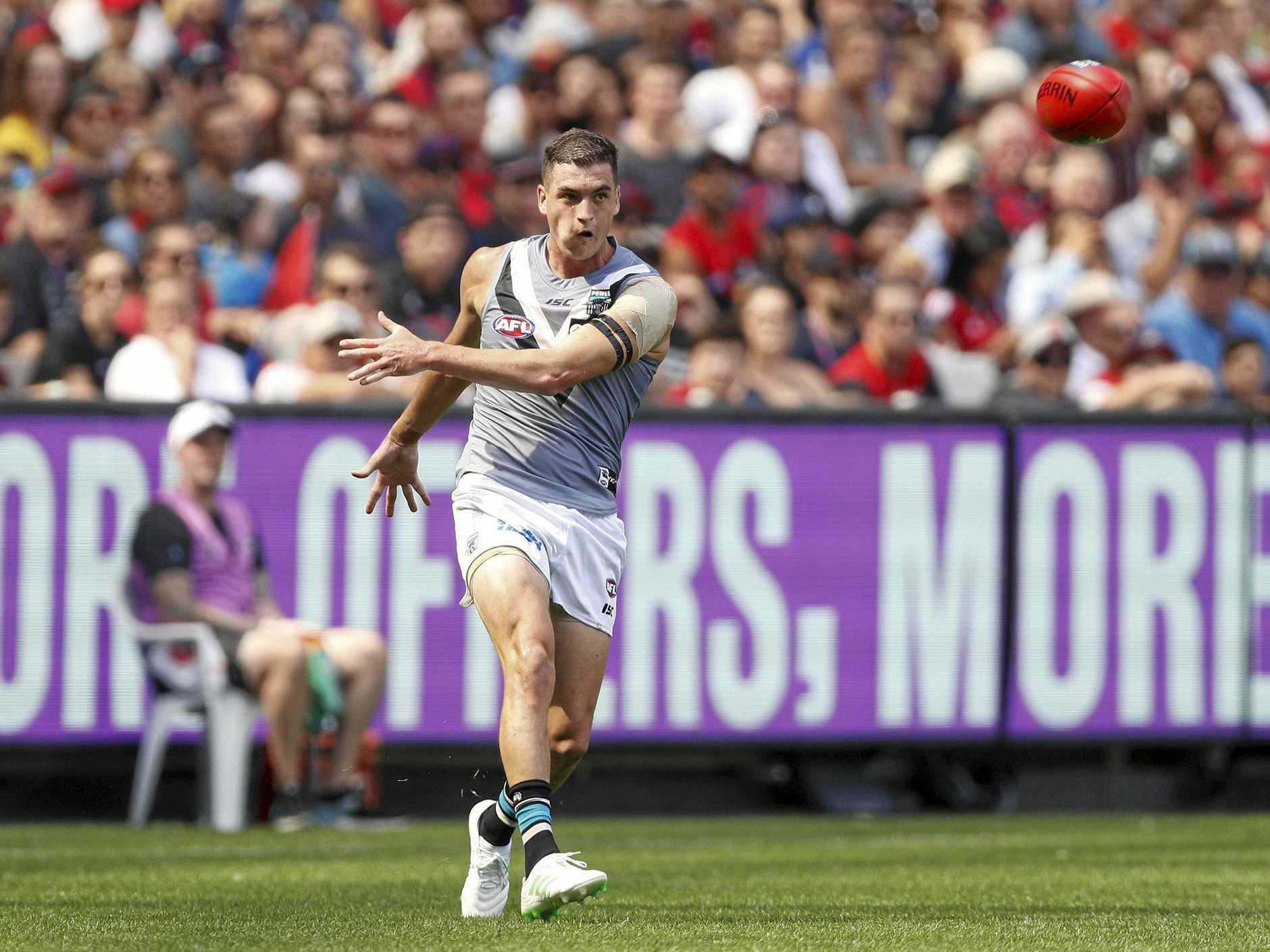 Tom Rockliff kicks Port Adelaide into attack in their opening round clash with Melbourne. Picture: Daniel Pockett/AAP