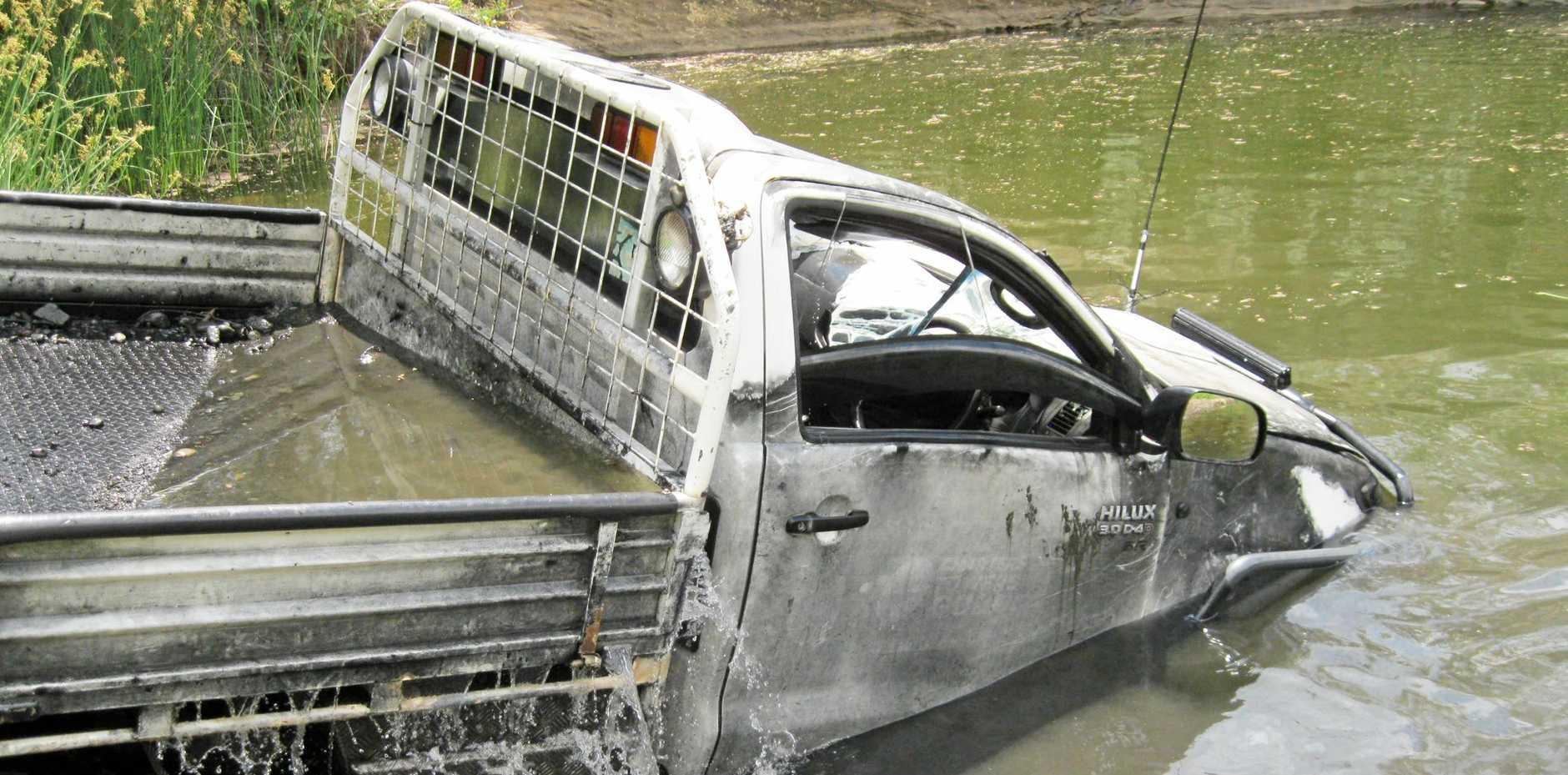 SUBMERGED: Police divers located the ute that was dumped at The Rockies, near Emu Vale.