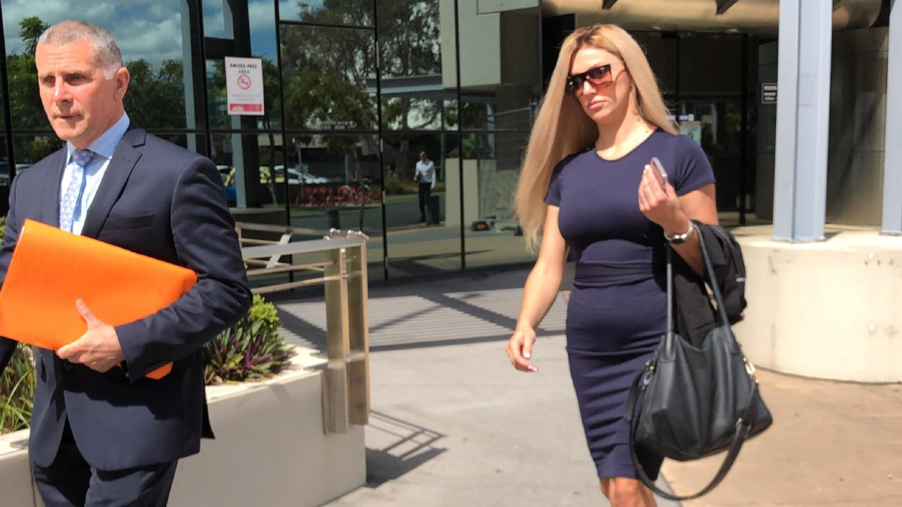 Tegan Louise Curtis leaves Southport Courthouse with her lawyer Mark Bamberry, of Bamberry Lawyers (left).