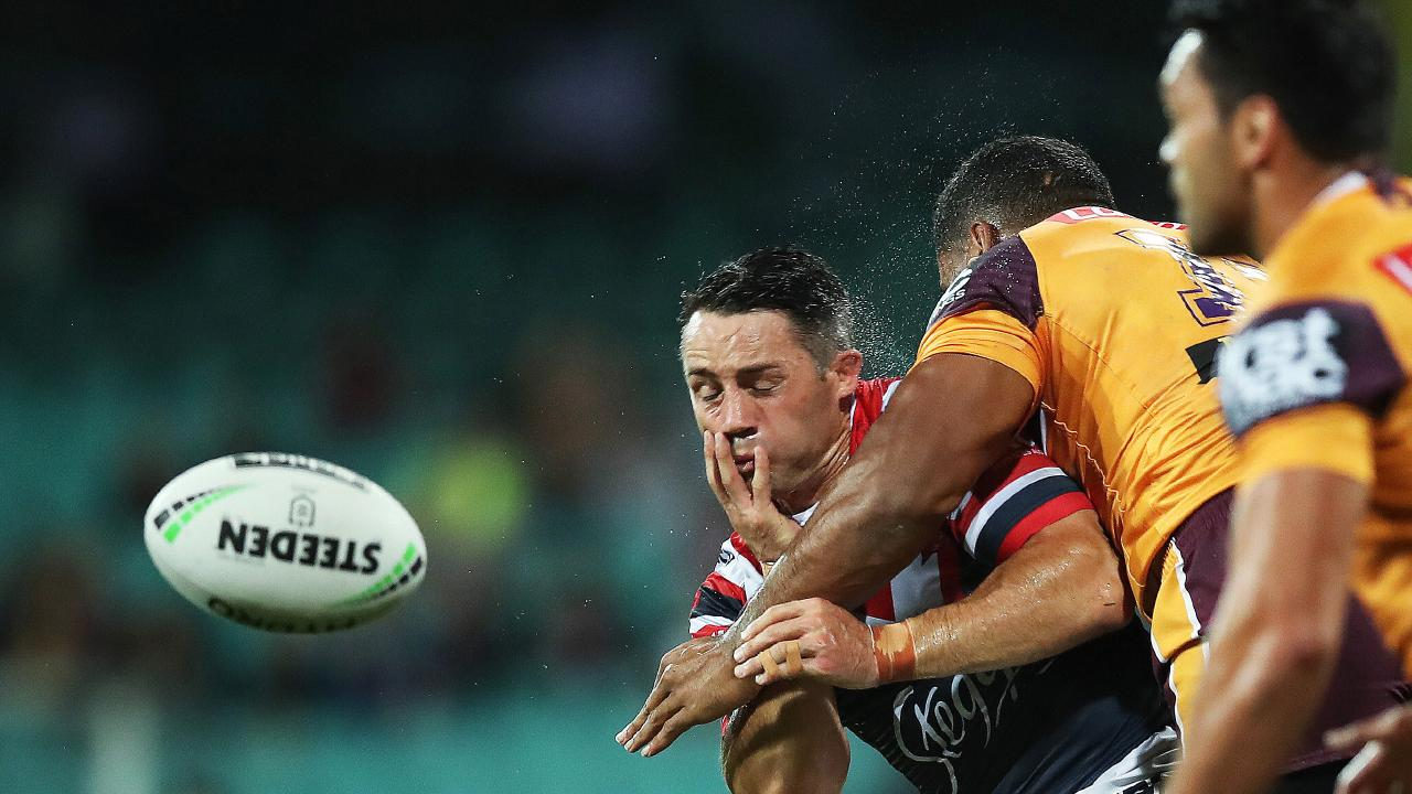 The Roosters' Cooper Cronk gets hit by Brisbane's Tevita Pangai Jr on Friday night. Picture. Phil Hillyard