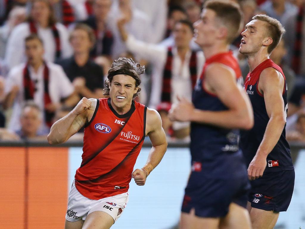 Andrew McGrath celebrates the sealer as the Demons lament. Picture: Getty Images