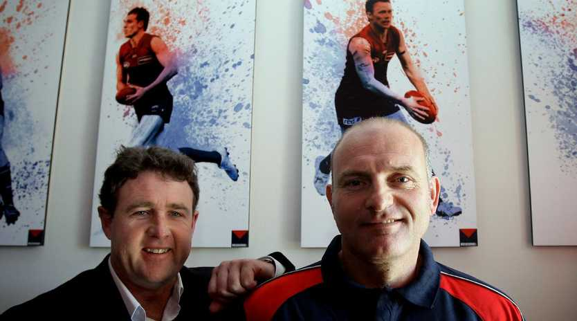 Melbourne football operations manager Chris Connolly with coach Dean Bailey.