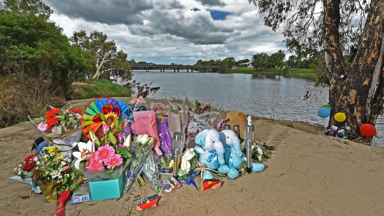 Floral tributes for the stepbrothers left on the banks of the Ross River at Cranbrook
