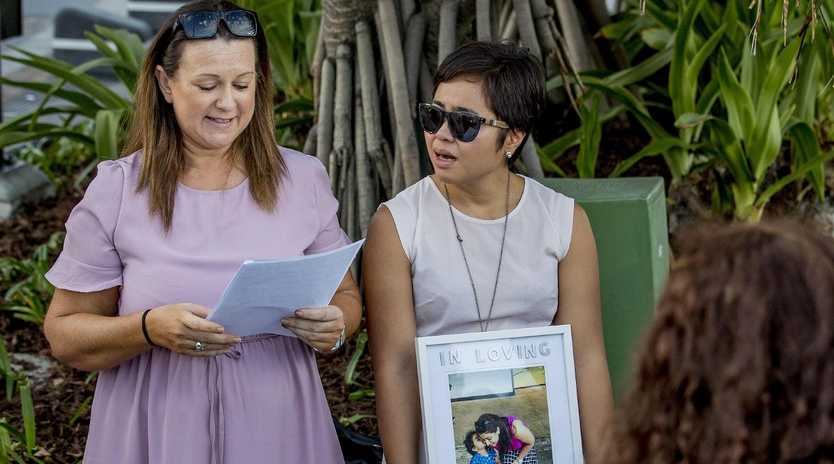 Friends and work colleagues laying flowers at Surfers Paradise Beach for Gold Coast nurse Ravneet Kaur. Picture: Jerad Williams
