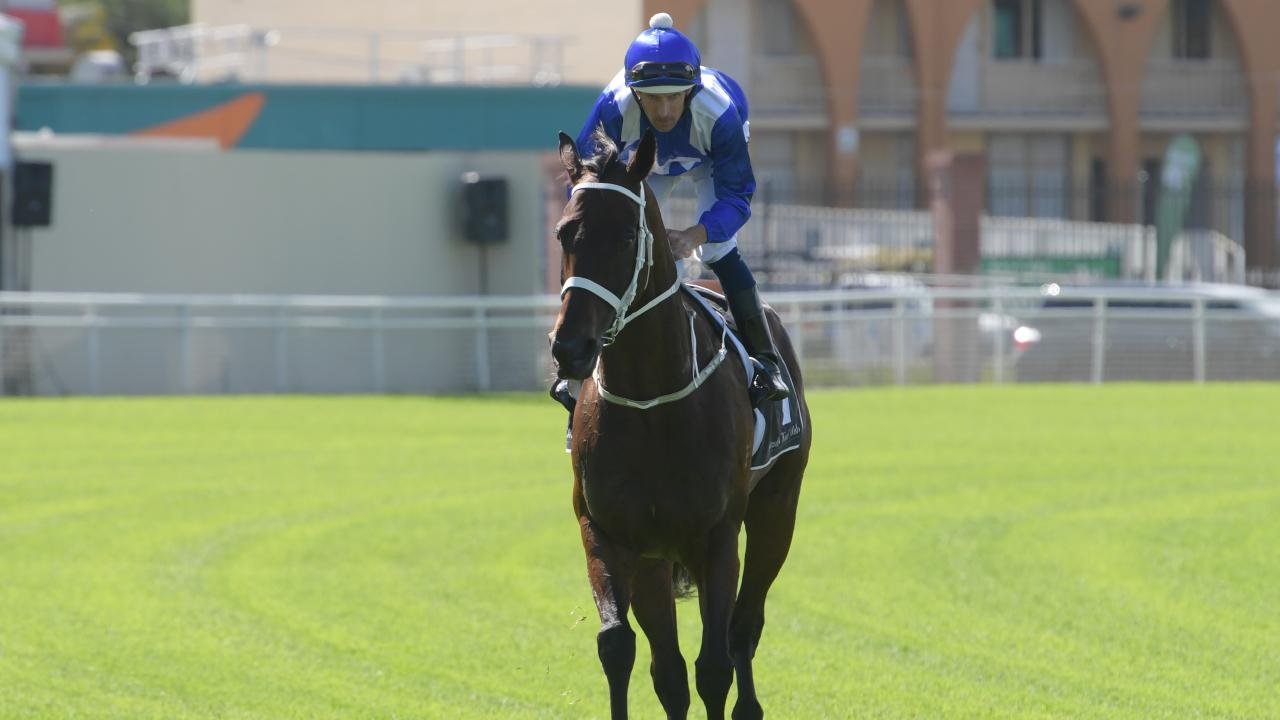 Jockey Hugh Bowman and Winx take part in an exhibition gallop at Randwick.
