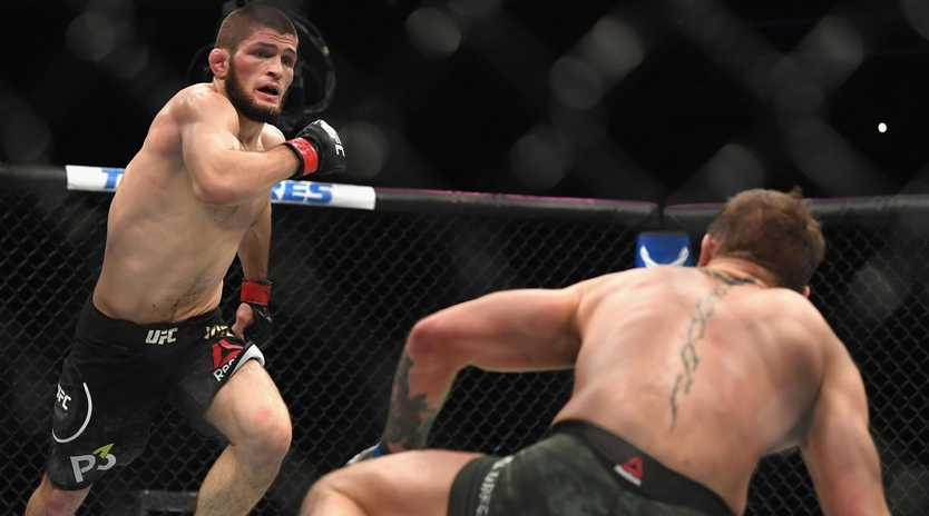 Khabib Nurmagomedov rushes a fallen Conor McGregor. Picture: Getty