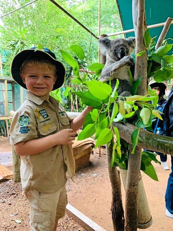 Owen Harris, pictured with a koala at Cooberie Park, is a wildlife warrior. He loves to play zookeeper and is raising money for wildlife conservation and one day hopes to meet Robert Irwin at Australia Zoo.