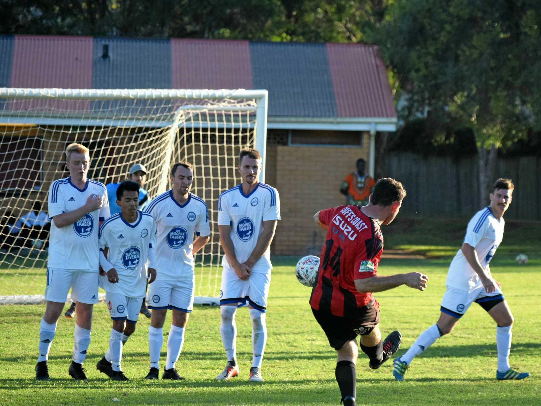 DEAD BALL MASTER: Coffs City United Lions player Garbahn Friel bends a kick through the Northern Storm wall on Saturday for his side's third goal.