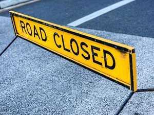 Two-truck crash closes road