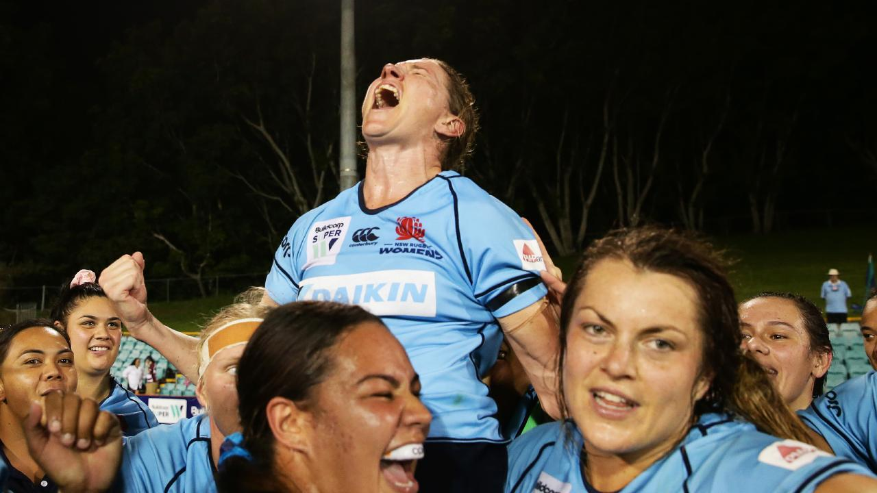 Ash Hewson is chaired off the field. Picture: Getty and team mates celebrate victory in the Super W Grand Final match between New South Wales and Queensland at Leichhardt Oval on April 07, 2019 in Sydney, Australia. (Photo by Matt King/Getty Images)