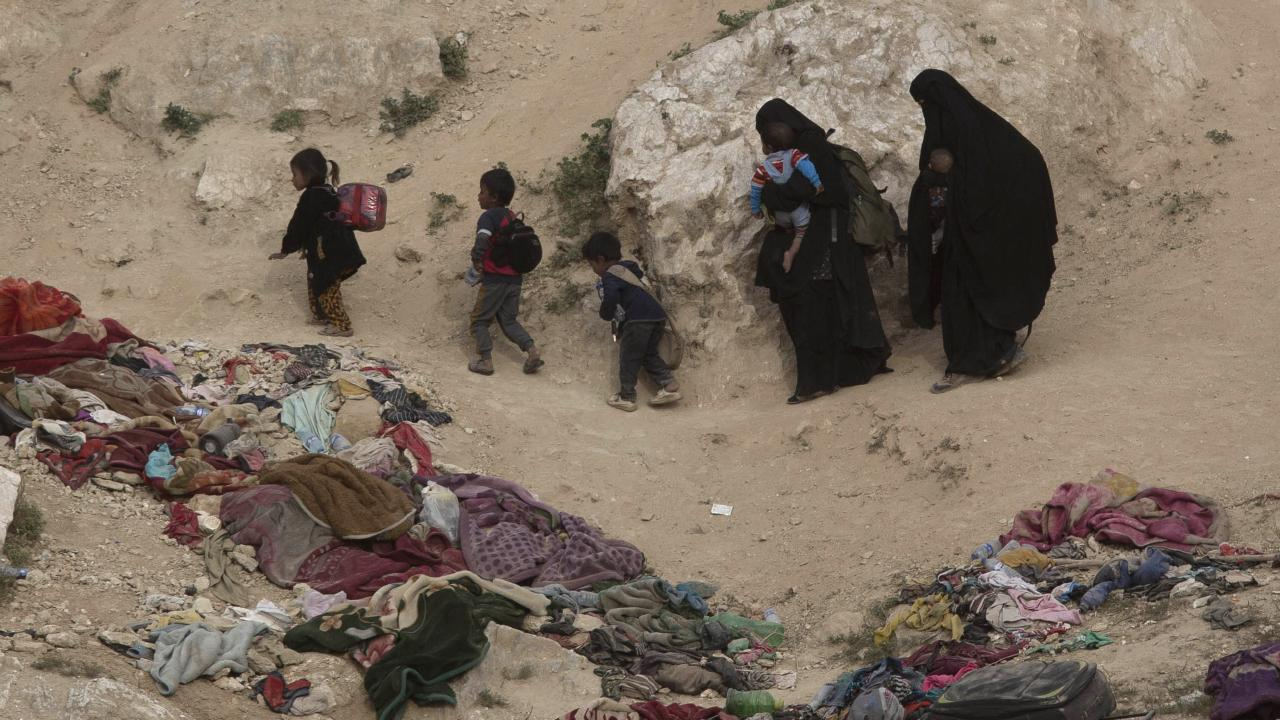 Women and their children who left the besieged Islamic State-held village of Baghouz, Syria. Picture: AP