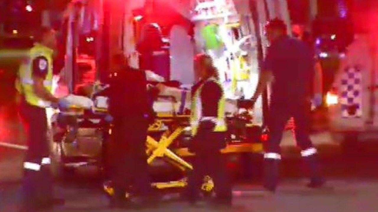 Paramedics load one of the injured into an ambulance after a massive fight erupted outside Melbourne's Crown Casino. Picture: Nine News