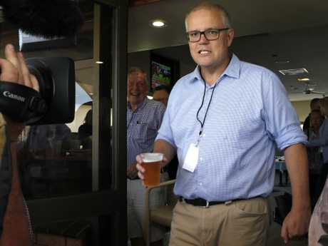 Shute Shield Rugby. Prime Minister Scott Morrison grabs a beer after his kick off of the game. Picture Chris Pavlich for The SundayTelegraph