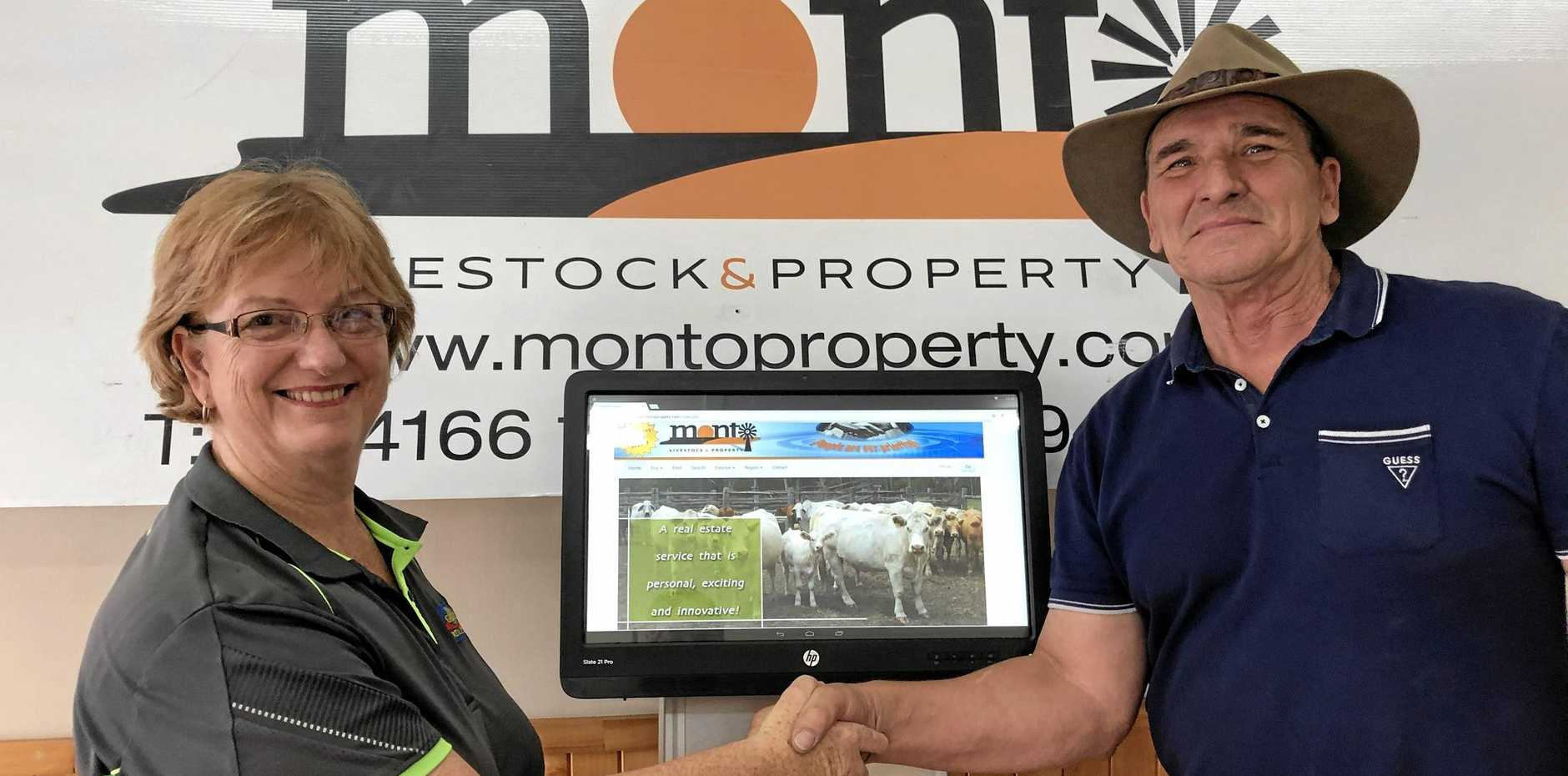DEAL: Galaxy Real Estate's Cheryle Rayson with outgoing principal Brett Allen, from Monto Livestock & Property.
