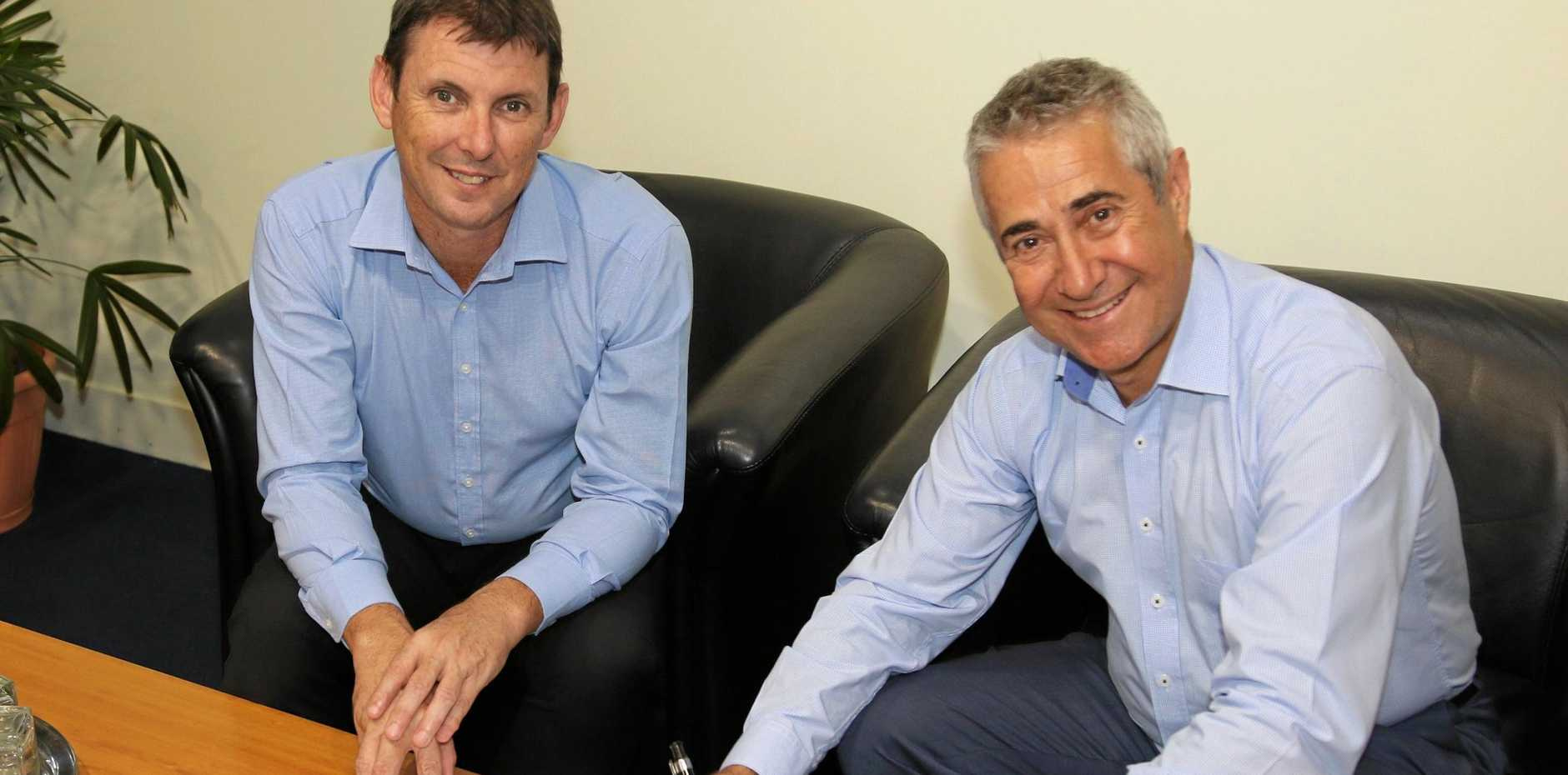 Mackay Regional Council CEO Craig Doyle and Managing Director of Taggle Systems John Quinn.