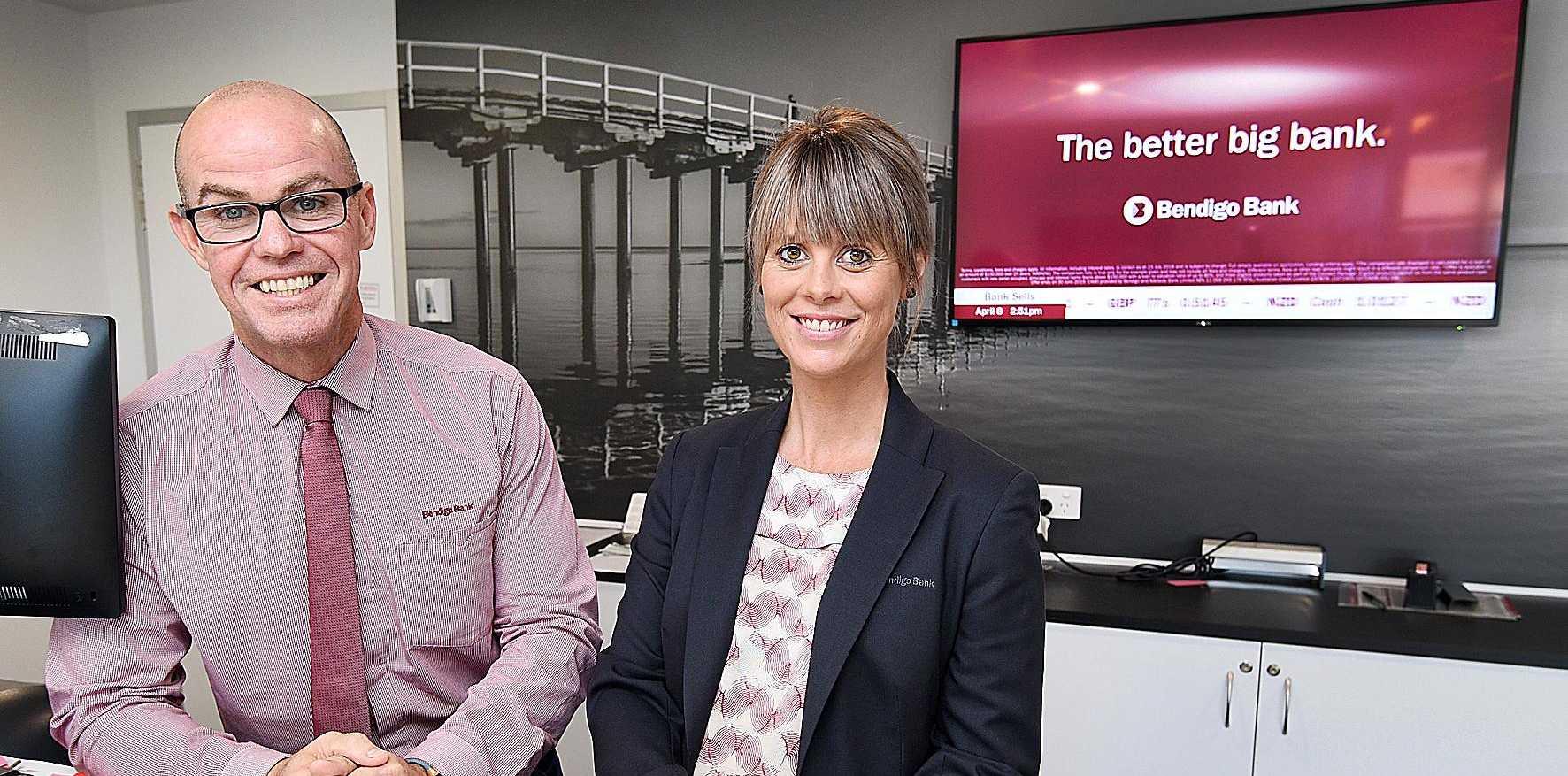 Bendigo Bank branch in Hervey Bay - branch mgr. Tim Evans and customer service officer Danni Krohn.