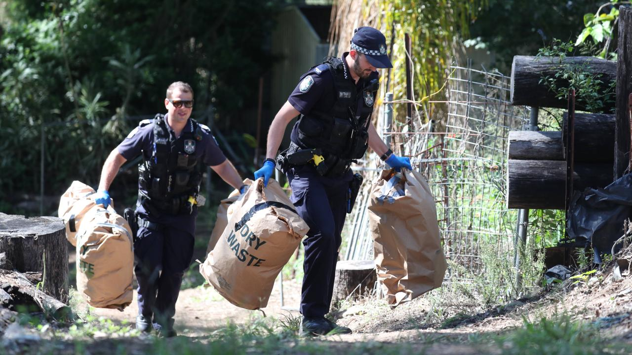 Police search the house in Goodna. Pic Annette Dew