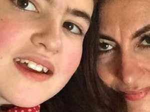 Mum arrested for snarky online comment