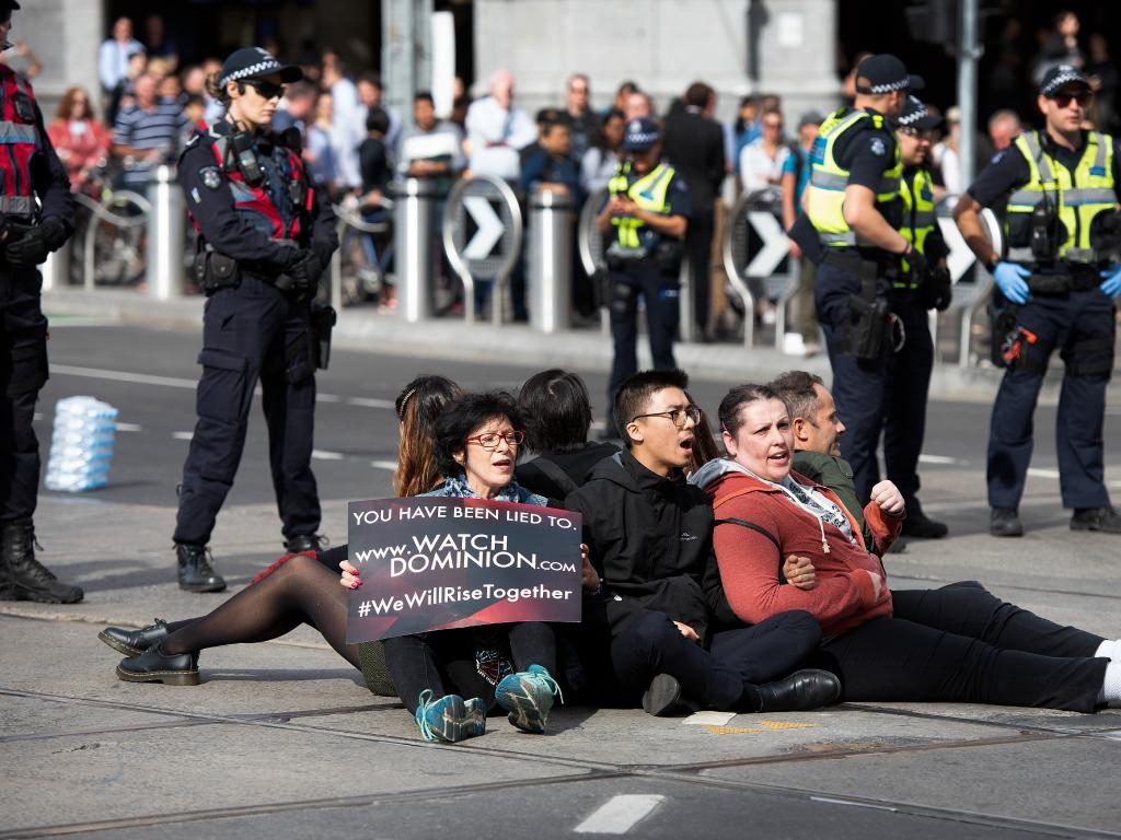 The last remaining protesters were dispersed from the middle of Melbourne's busiest intersection. Picture: Ellen Smith/AAP