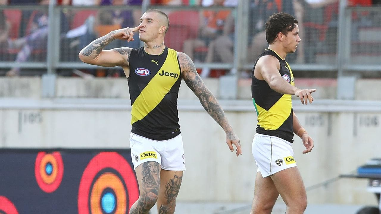 Dustin Martin directs a snorting sledge to a GWS player. Picture: Getty Images