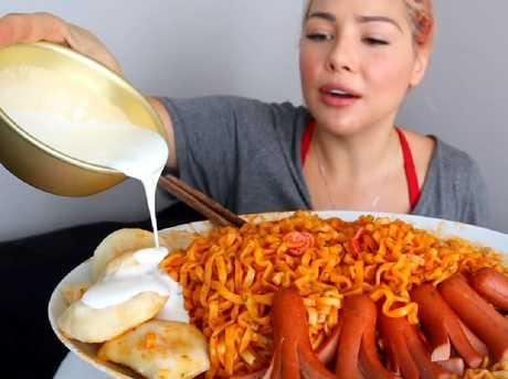 Mukbang can involve other foods such as ramen noodles and combining them with other foods. Picture: YouTube