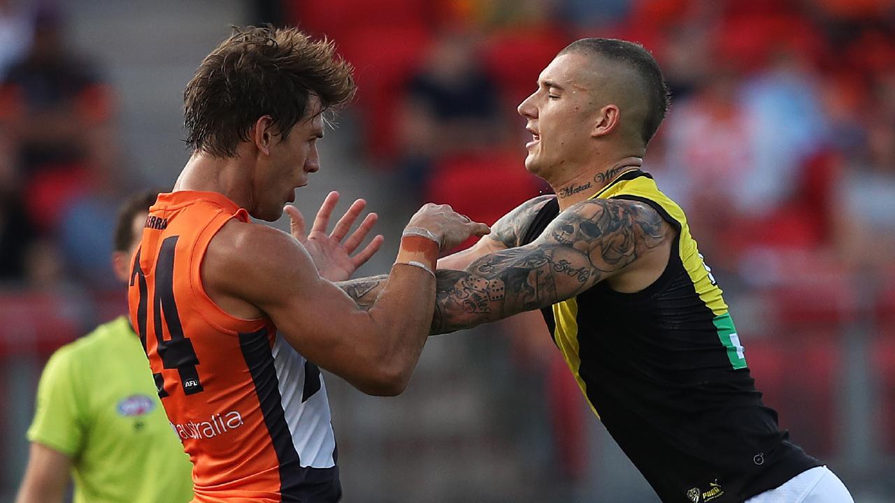 A frustrated Dustin Martin gives Matt de Boer a shove. Picture: Phil Hillyard