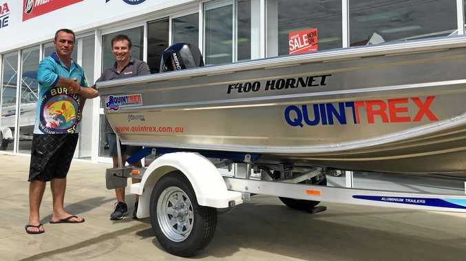 TOP PRIZE: Burrum Heads Fishing Club president Brad Dyson thanks Paul Smith from Bay City Marine for their terrific support of the 2019 Easter Fishing Classic. The Hervey Bay business has donated a $14,500 boating package as the major prize of this year's comp.