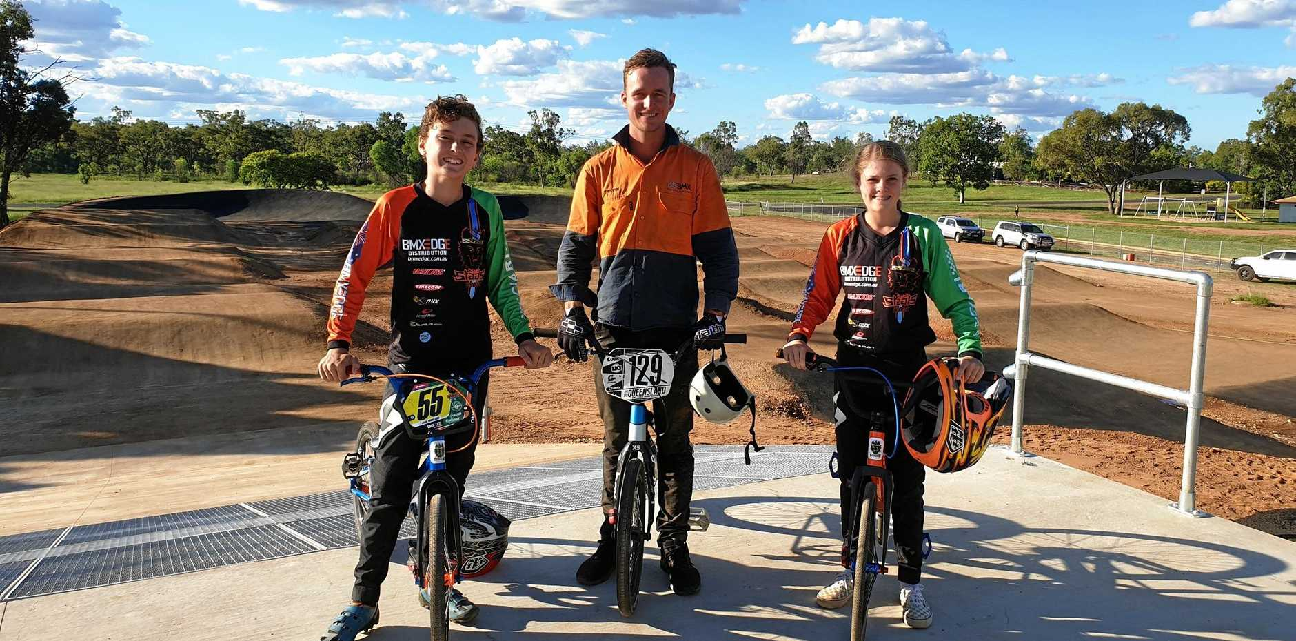 TESTING TIMES: Jacob and Darcie Moore with Australian BMX champion Tristyn Kronk at the Clermont BMX track.