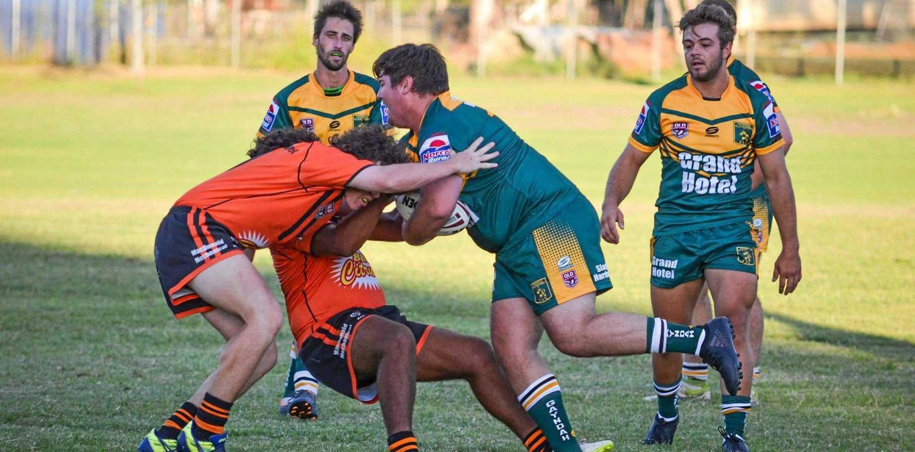 HEAD ON: Gayndah Gladiators' Jaybin Pearce slams into Mundubbera Tigers' defensive line. Photo courtesy Robyn Geddes.