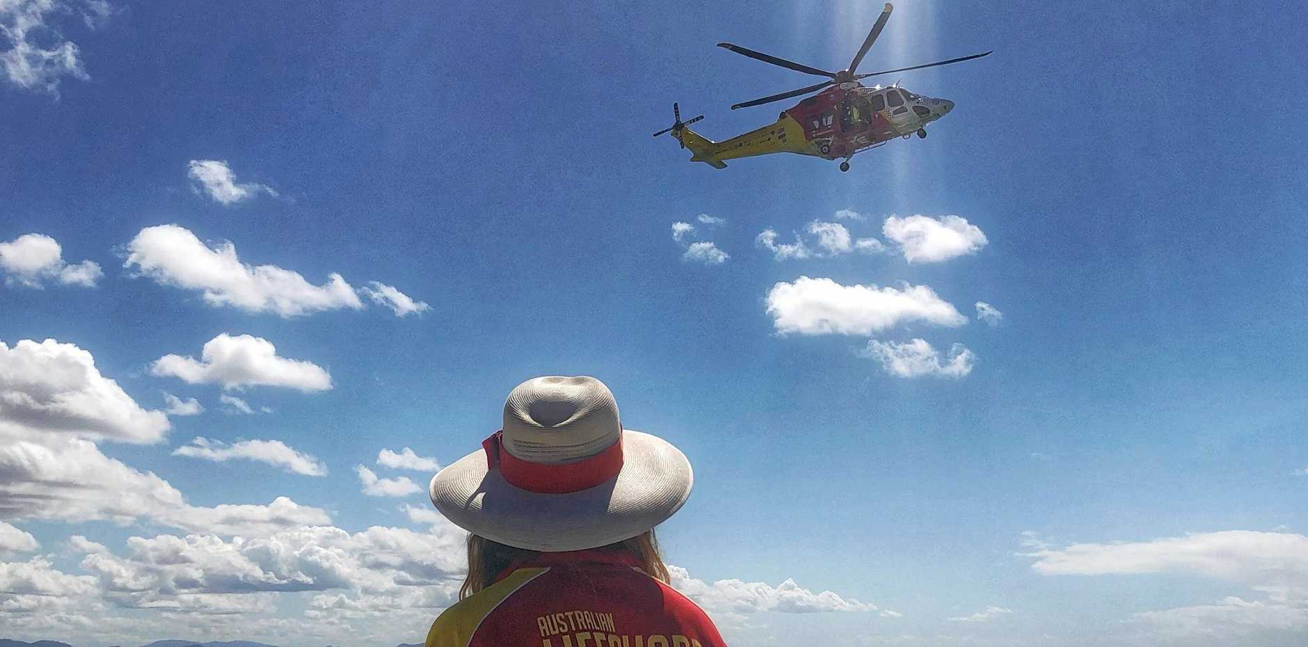 ANGEL Westpac Rescue Helicopter hovers over Clarkes Beach ready to transfer a patient to Gold Coast Hospital.