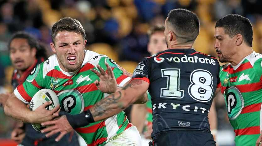 Samuel Burgess of the Rabbitohs (left) is tackled by Gerard Beale of the New Zealand Warriors.
