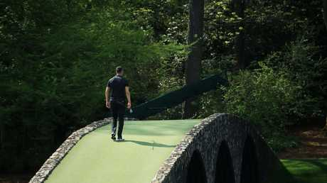 The cameras are always rolling... Martin Kaymer walks across the Hogan Bridge. Picture: Getty