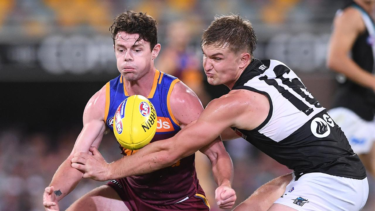 Brisbane's Lachie Neale and Port Adelaide's Ollie Wines fight for possession during their Round 3 clash at the Gabba. Picture: Dave Hunt