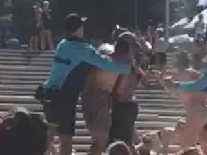 Wild wrestling stuns beachgoers