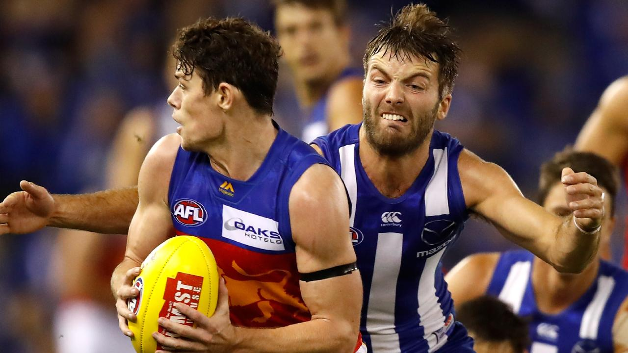 Lachie Neale (left) has produced back-to-back career-best games, notching 43 disposals against both North Melbourne and Port Adelaide. Picture: Dylan Burns