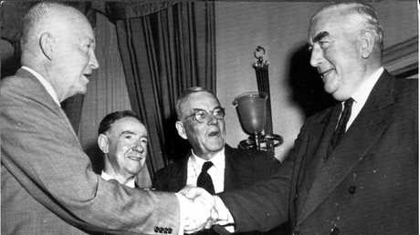 Noted golf fan, and former US President Dwight Eisenhower (L) greets Australian Prime Minister Robert Menzies (R). Picture: Press United