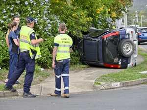 PHOTOS: Car flips in crash at busy inter