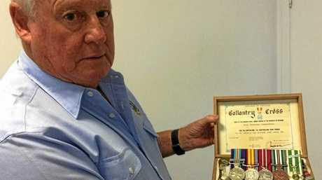 SOLDIER'S SPIRIT: Peter Sweet displays his Vietnam War medals.