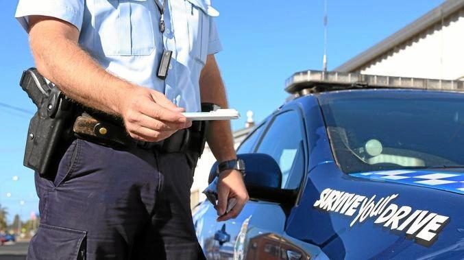 ROADSIDE: Generic drug driving image with police officer.