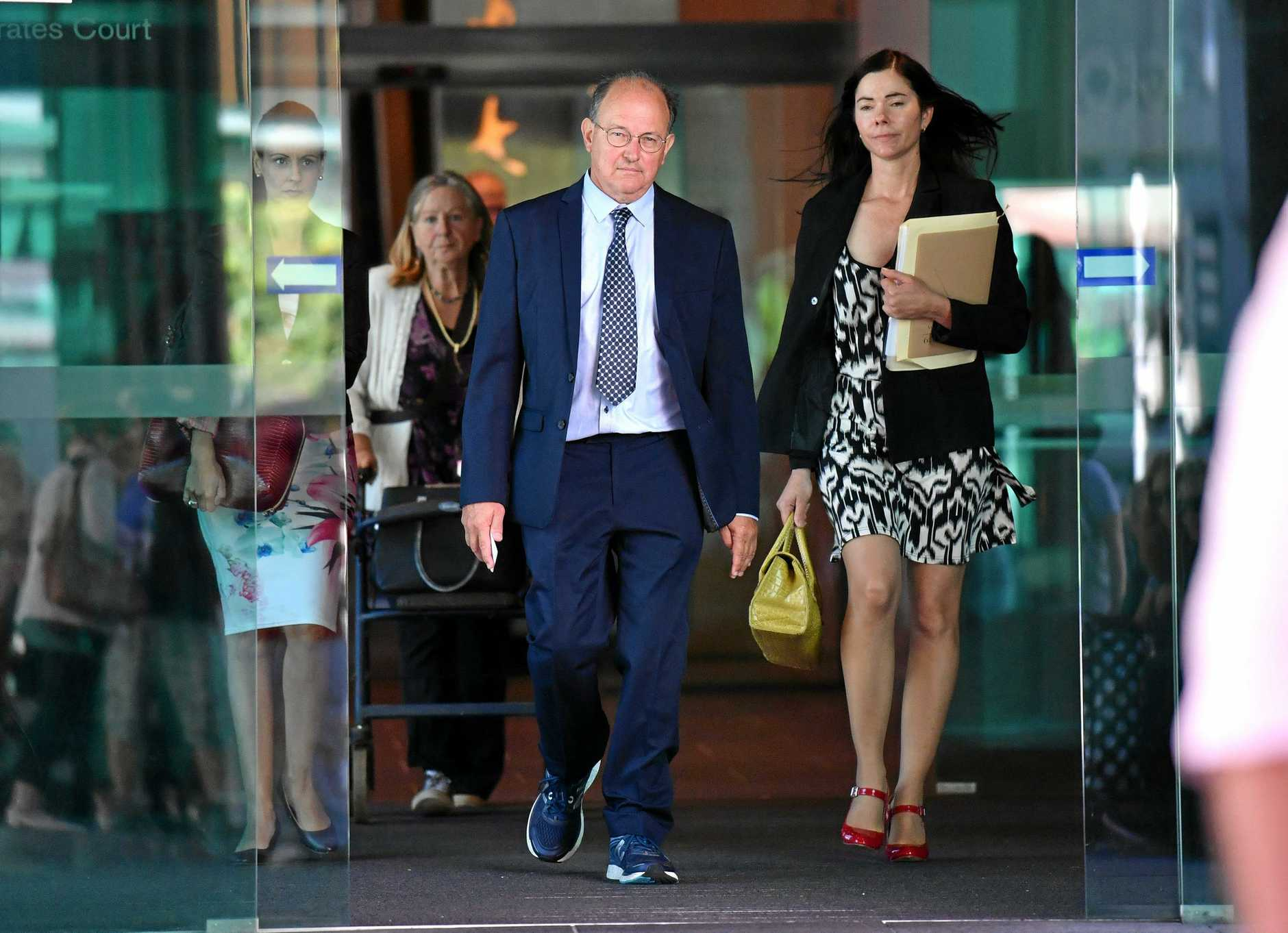 Dr William Russell Massingham Pridgeon (centre)  leaving the Brisbane Magistrates Court in Brisbane, Friday, April 5. Dr Pridgeon is is facing charges for his alleged role in an abduction ring network that helped mothers kidnap their children.