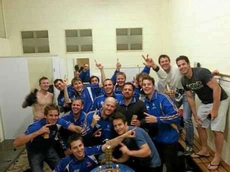 Lachy and his team in the sheds after the grand final win last year.