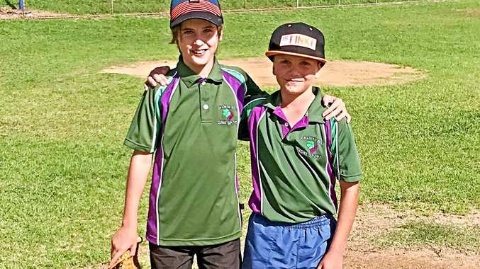 STEP UP: Braylen Harvey (right) with Coen Cook. Braylen has been selected to represent the Darling Downs for softball.