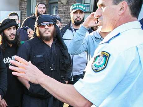 Elomar (left) and Sharrouf (centre with sunglasses) at a 2012 riot in Sydney, Australia.