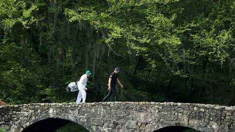 Calm before the storm... England's Matt Wallace walks across the Nelson bridge on the 13th hole during a practice round prior to The Masters at Augusta National Golf Club on April 08, 2019 in Augusta, Georgia. (Photo by Andrew Redington/Getty Images)