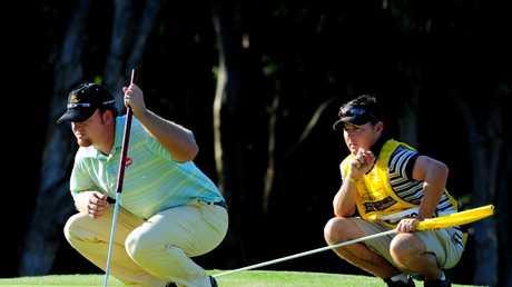 A familiar sight... JB Holmes agonises over a putt. Picture: Patrick Hamilton